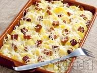 Запечени картофи със сирене, шунка и кашкавал